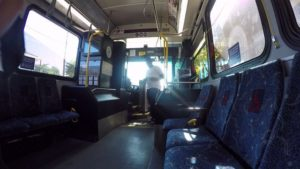 Bus interior with side facing seats